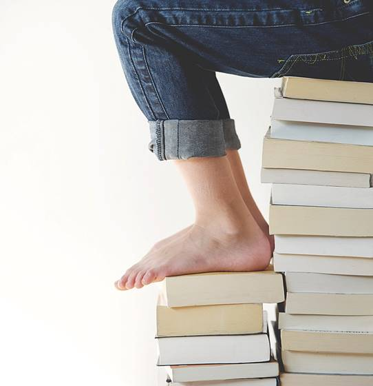 feet on book