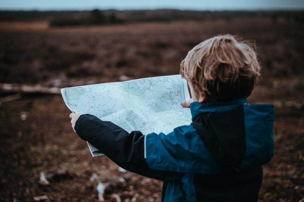 Boy reads map